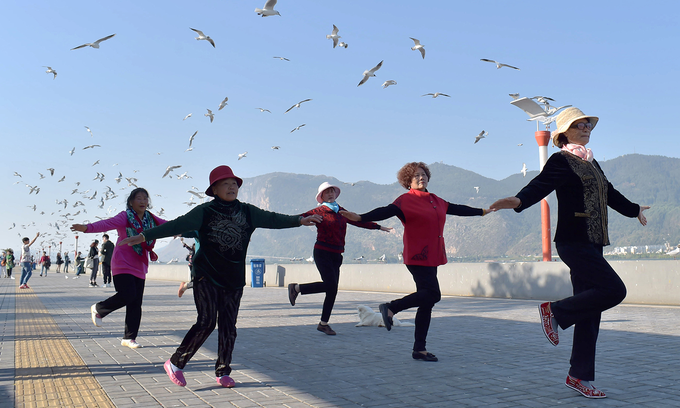 Chinese pensioners exercise in a park. <em>Photo by Jie Zhao/Getty</em>