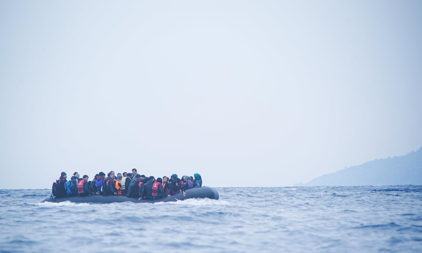 A refugee boat off the coast of Lesbos, Greece. <em>Courtesy Wikipedia</em>