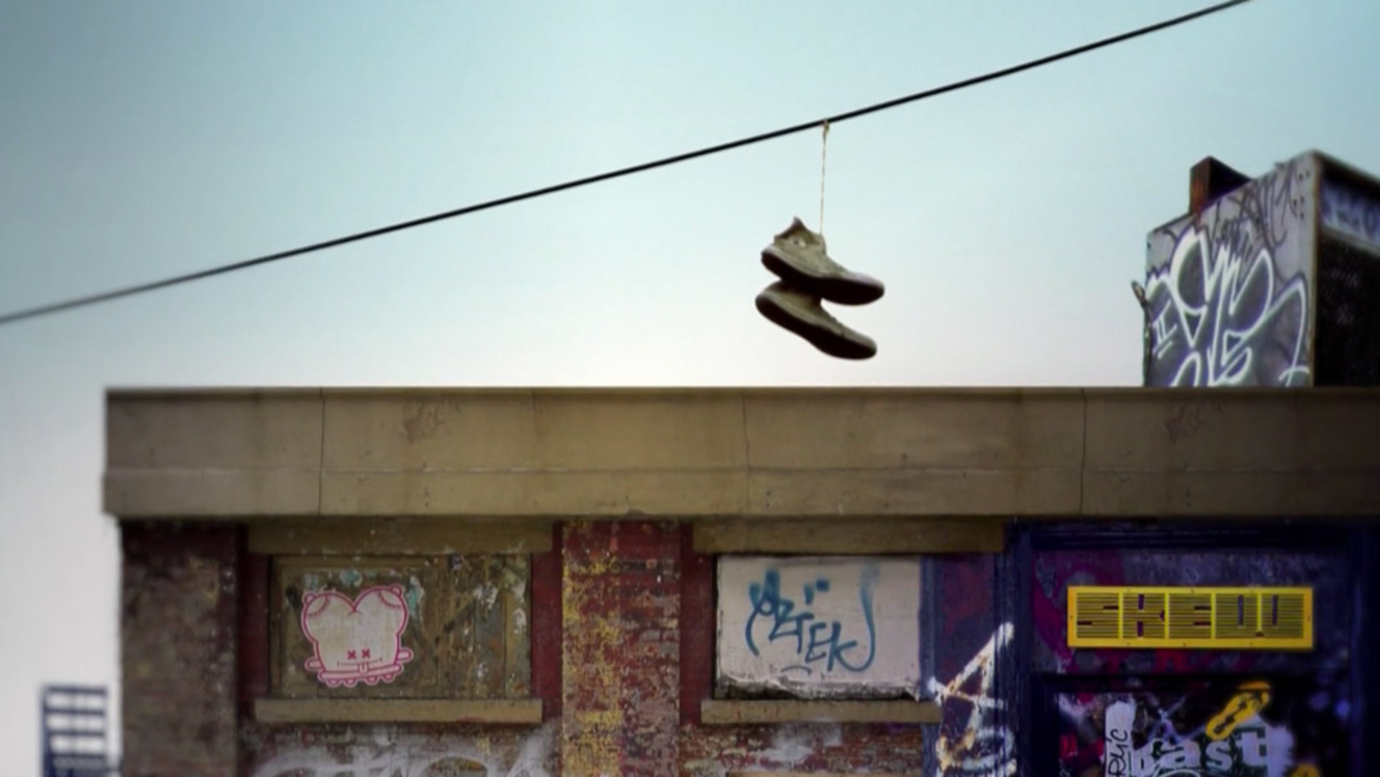 what u2019s behind the urban meme of shoes hanging from overhead wires
