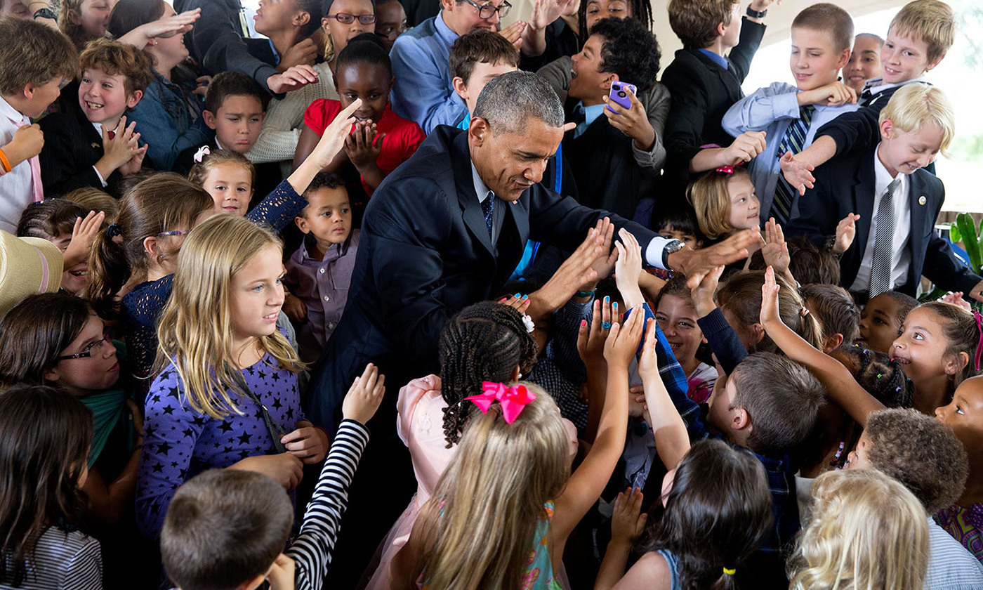 Former President Obama greets children at the US Embassy in Nairobi, Kenya in 2015. <em>Official White House photo by Pete Souza</em>