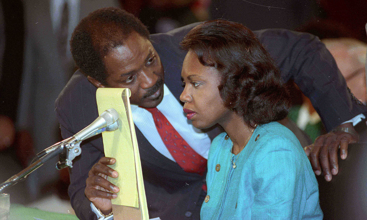 <p>Counsel Charles Ogletree advises the law professor Anita Hill during her testimony on 11 October 1991. <em>Photo by Rick Wilking/Reuters</em></p>