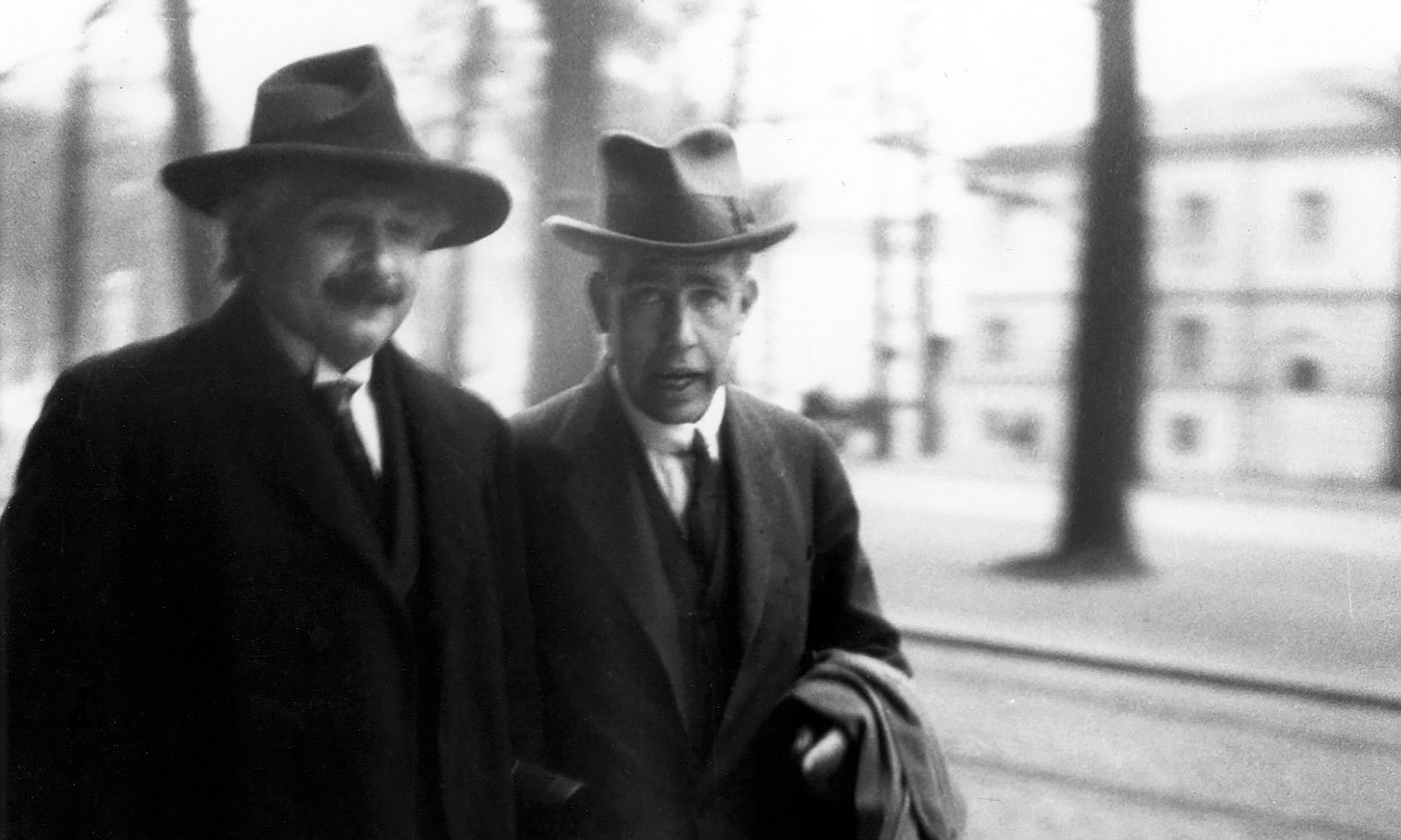 <p>Is or is not? Albert Einstein and Nils Bohr attend the Solway conference in 1920 in Brussels, Belgium. <em>Photo courtesy Wikipedia</em></p>
