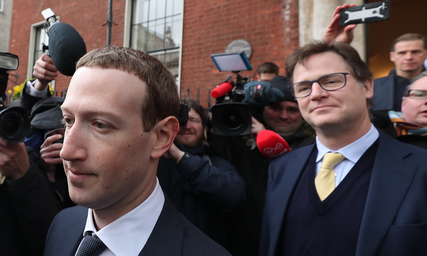 <p>Nick Clegg, former British deputy prime minister and Facebook's new vice president of global affairs and communication, stands behind Facebook CEO Mark Zuckerberg. <em>Photo by Niall Carson/PA/Getty</em></p>