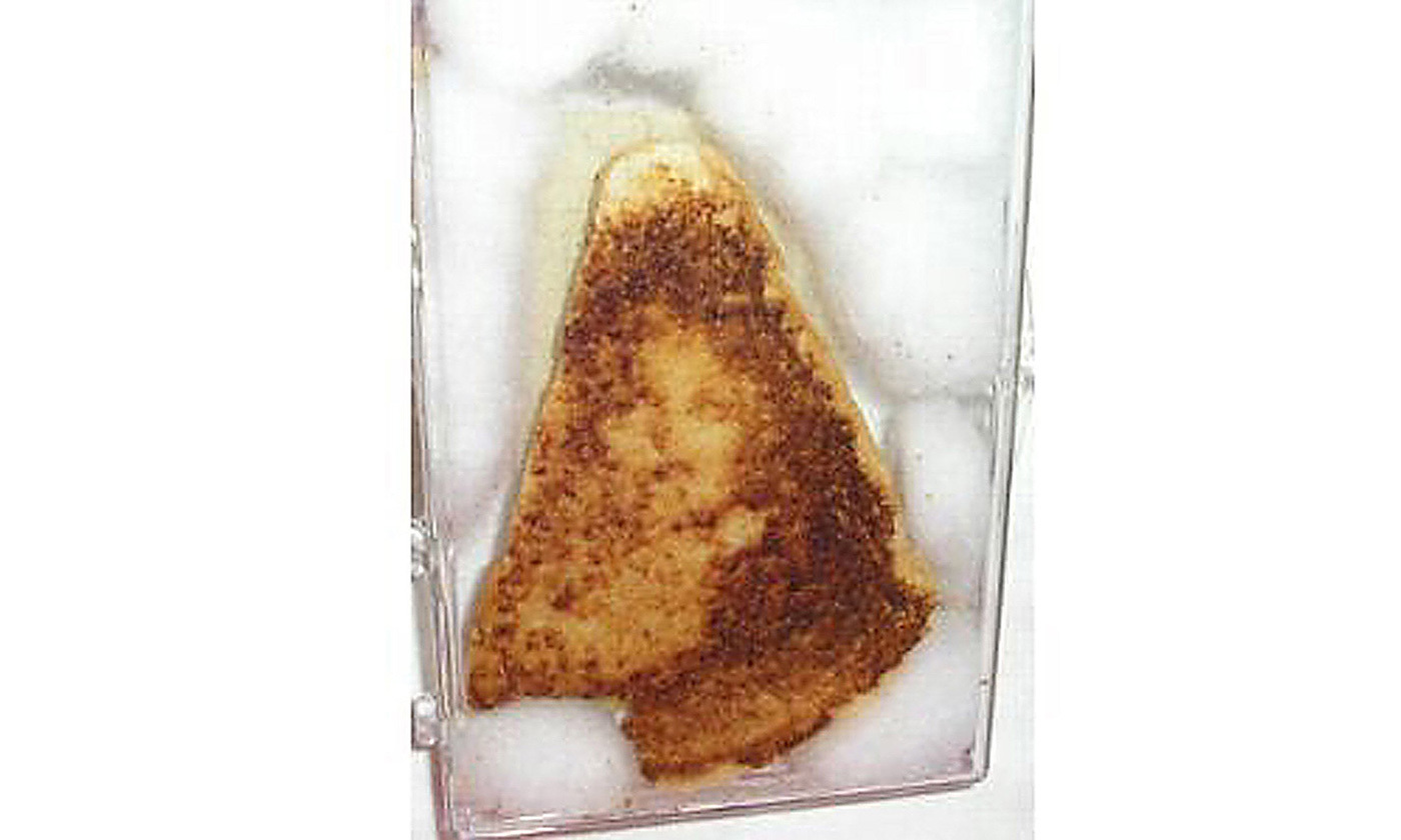 <p>The Virgin Mary appeared on a ten-year-old cheese sandwich. <em>Photo courtesy Ebay/Getty</em></p>